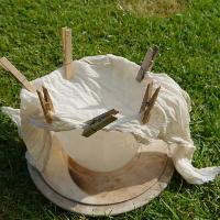 plastic jug with muslin cloth pegged on ready to strain elderflower