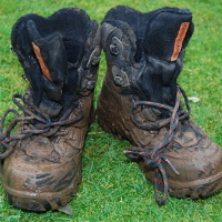 a pair of very muddy boots