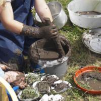 mixing mud with muddy utensils