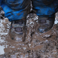 standing in a very muddy puddle