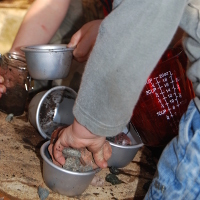 playing with pots full of stones